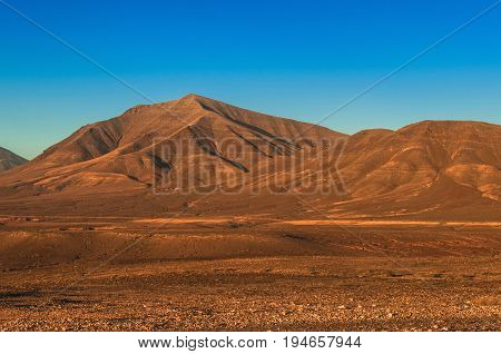 Desert Mountain,Barren with Clear Blue Sky with copy space