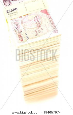 Pile of pound banknotes with seal on white background