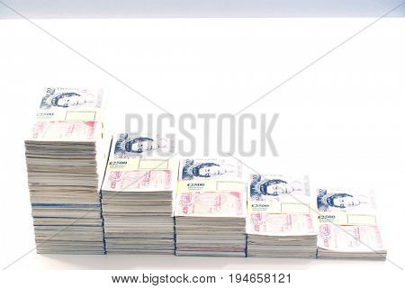 Piles of sealed pound banknotes