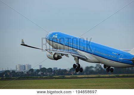 Amsterdam the Netherlands - July 6th 2017: PH-AKB KLM Royal Dutch Airlines Airbus A330 takeoff from Polderbaan runway Amsterdam Schiphol Airport