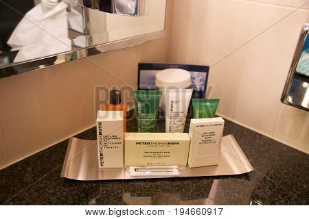 VIENNA, AUSTRIA - APR 28th, 2017: Hotel Amenities shower bath and soap, actual photography in hotel environment at a Penthouse Suite by Hilton.