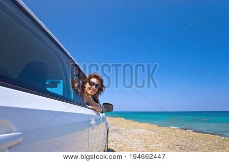 Happy Woman Travelling On A Car .