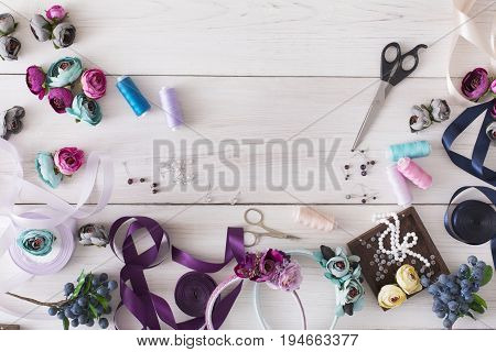 Making jewelry, home workshop. Flat lay, tools and materials for creating accessory with beads and ribbons, top view, copy space. Beauty, creativity, handicraft concept