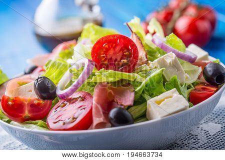 Salad. Fresh Summer Lettuce Salad.healthy Mediterranean Salad Olives Tomatoes Parmesan Cheese And Pr