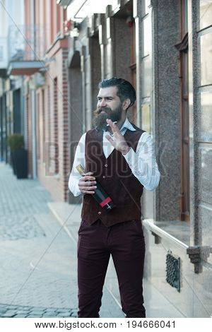 Happy Man Smoking Cigarette With Bottle Of Wine