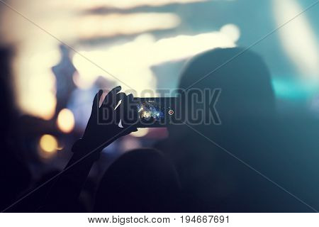 Cheering crowd at concert, night entertainment, music festival, happy youth, luxury party