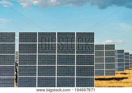 Solar panels of a power station, standing in a row, close-up