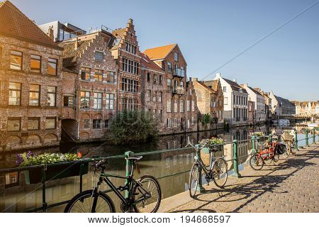 Riverside view with beautiful old buildings and bicycles during the morning light in Gent city, Belgium