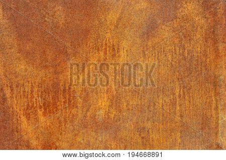 Orange brown old rusted corroded metal or steel sheet horizontal wall background as abstract dirty textured metallic vintage industrial closeup