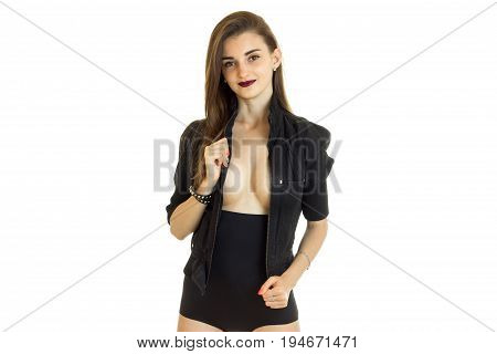 cheerful brunette woman in black jacket and panties with big silicon breasts isolated on white background