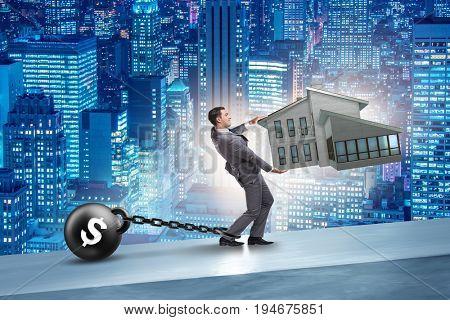 Businessman in mortgage debt financing concept