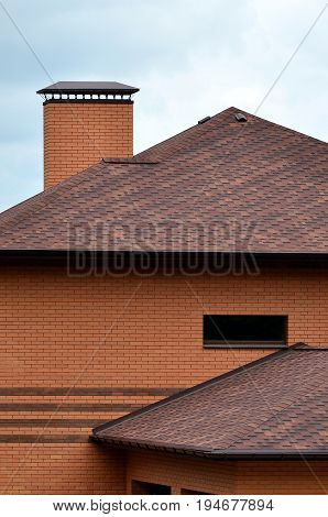 The House Is Equipped With High-quality Roofing Of Shingles (bitumen Tiles). A Good Example Of Perfe
