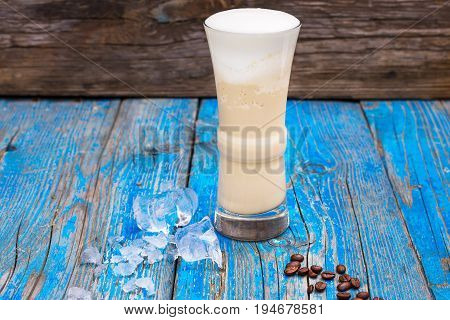 Raf Coffee With Homemade Syrup, On An Old Wooden Background