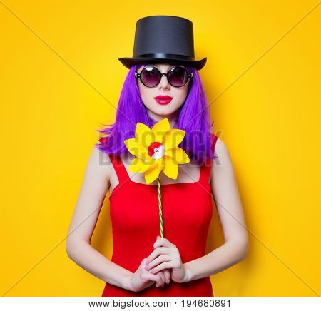 Girl With Purple Color Hair And Pinwheel Toy