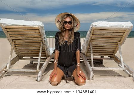 Beautiful woman wearing in black dress and Vietnamese Conical Hat (Non La) hat.