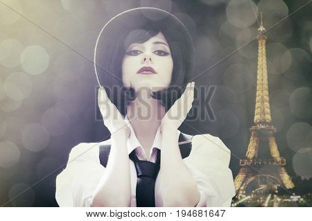 Fashion Brunette Girl In Hat. Studio Shot With Backlight.