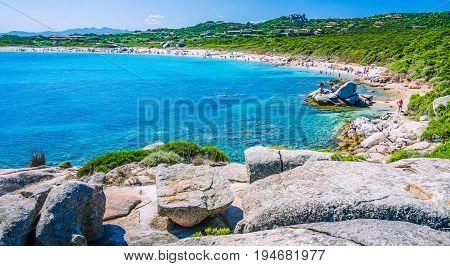 Azure beach full tourist at Porto Pollo on beautiful Sardinia island Sardinia, Italy.