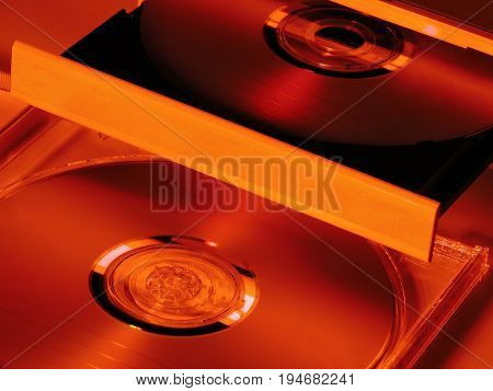 CD player with two CD close-up. Orange and yellow colors.