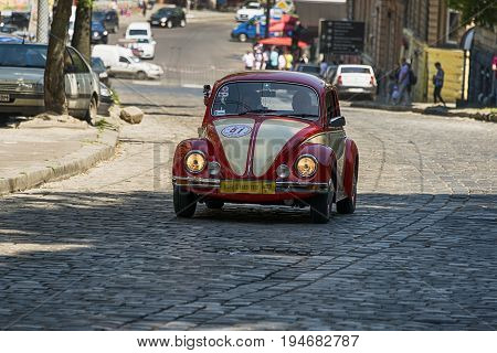 Lviv Ukraine - June 4 2017: Old retro car Volkswagen KAFER with its owner and au unknown passenger taking participation in race Leopolis grand prix 2017 Ukraine.