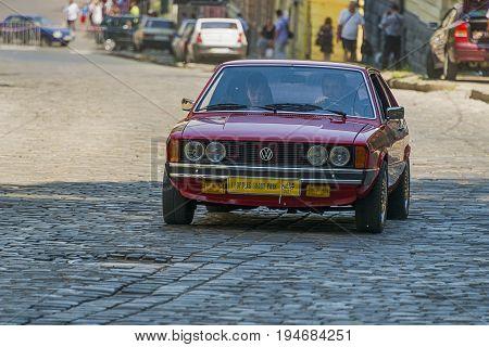 Lviv Ukraine - June 4 2017: Old retro car Volkswagen Scirocco with its owner and au unknown passenger taking participation in race Leopolis grand prix 2017 Ukraine.