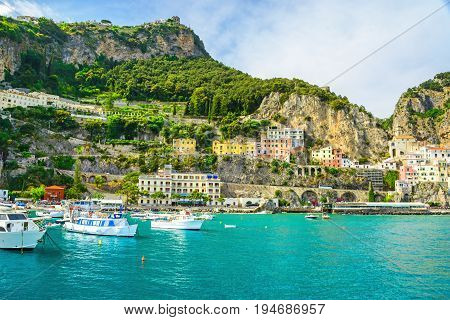 beautiful view of Amalfi town on Amalfi coast from the sea with yachts and boats Campania Italy