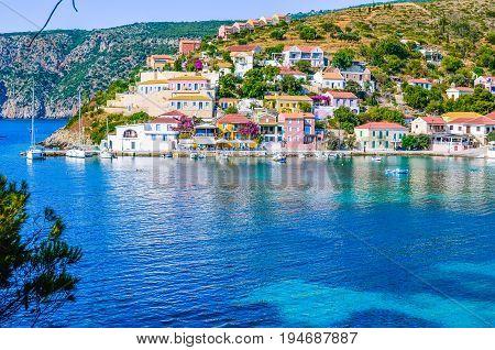 Assos village in beautiful azure cove in Kefalonia, Greece.