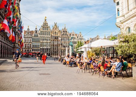 ANTWERPEN, BELGIUM - June 02, 2017: View on the crowded cafe terrace on the Grote Markt square in Antwerpen city, Belgium