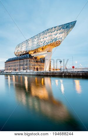 ANTWERPEN, BELGIUM - June 02, 2017: Night view on the illuminated Port House building designed by Zaha Hadid architect in 2009 in Antwerpen city, Belgium