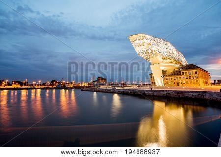 ANTWERPEN, BELGIUM - June 02, 2017: Night view on the illuminated Port House building designed by Zaha Hadid architect in 2009 in Antwerpen city, Belgium