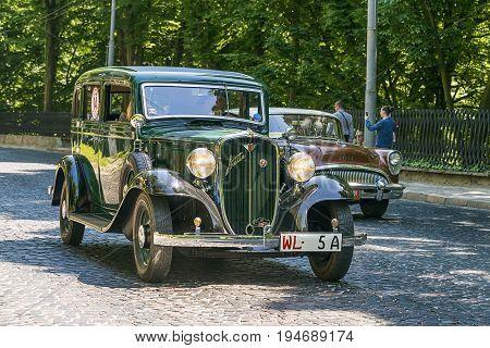 Lviv Ukraine - June 4 2017:Old retro cars Fiat 518 and Buick Special taking participation in race Leopolis grand prix 2017 Ukraine.