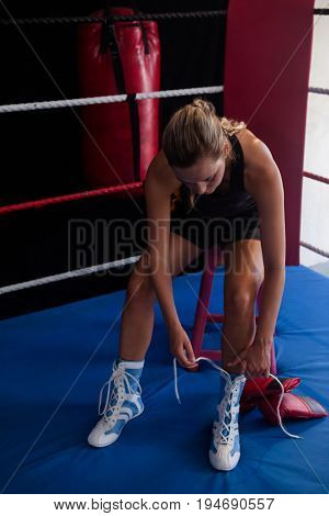 Woman wearing shoes in boxing ring at fitness studio