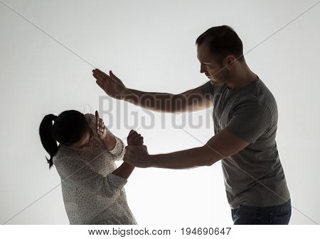 domestic violence, people and abuse concept - couple having fight and man slapping woman