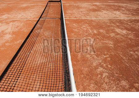 Tennis court and tennis net with shadow