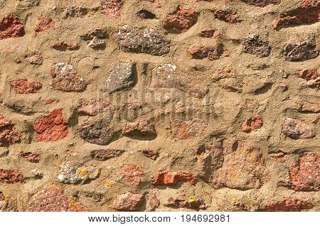 Old Rustic Stonewall Background, rough and crumbling