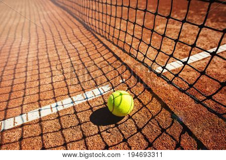 Close up of tennis ball on clay court. Tennis ball