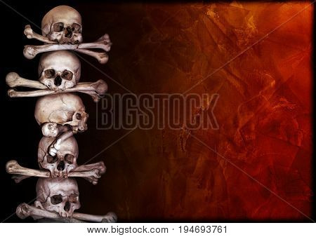 Grunge background with human skulls, bones and old stucco wall texture. Copy space for your text