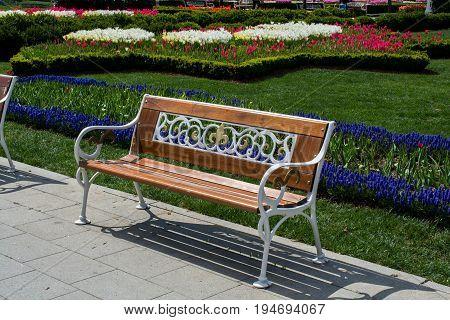 Wooden decorative park bench at a park