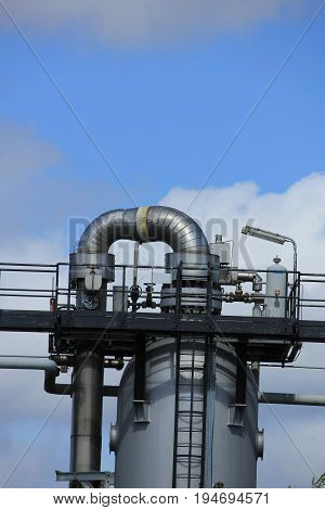 Silos and heavy metal pipes of an industrial plant Chemical industrial industry
