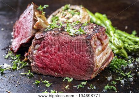 Barbecue Wagyu Point Steak with green Asparagus and Mushroom Cap as close-up on a rusty metal sheet