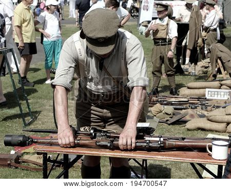 Sandhurst, Uk - 18Th June 2017: Vintage Toned Shot Of An Enthusiast Demonstrating A Lee Enfield Rifl
