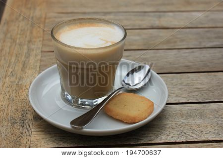 French Cappuccino coffee with warm frothed milk served in a glass