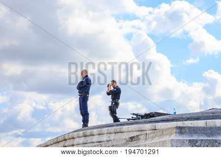 PARIS, FRANCE - JULY 2, 2017: military snipers keeping security after recent terrorist attacks in Paris. Arc de Triomphe at Place Charles de Gaulle.