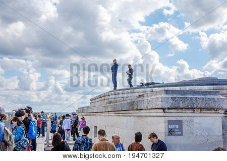 PARIS, FRANCE - JULY 2, 2017: snipers of French special corps on top of Arc de Triomphe on duty for tourists security.