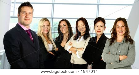 Leading Businessman With Women Business Team