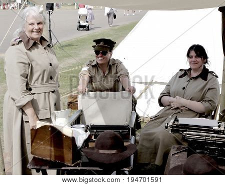 Sandhurst, Uk - 18Th June 2017: Vintage Toned Shot Of Enthusiasts In Ww2 Female Period Costume At A
