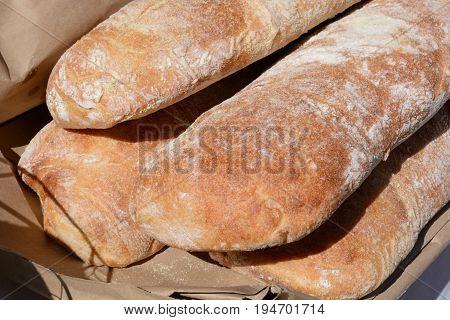 Loaves of ciabatta Italian slipper bread on display a farmer's market