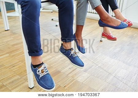 Feet and shoes of group of young people waiting