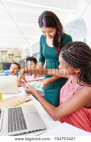 Young women in training at start-up company