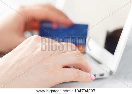 Online Payment,woman's Hands Holding And Using Credit Card For Online Shopping