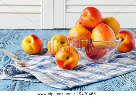 Still life nectarine in glass bowl on table